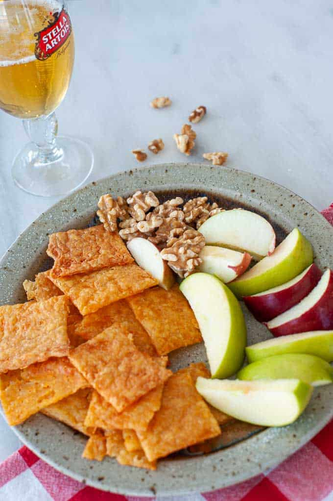 plate of sourdough crackers and apple wedges