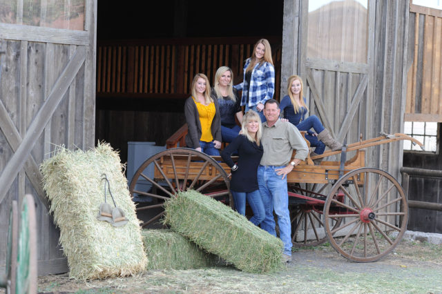 rustic family photo with barn