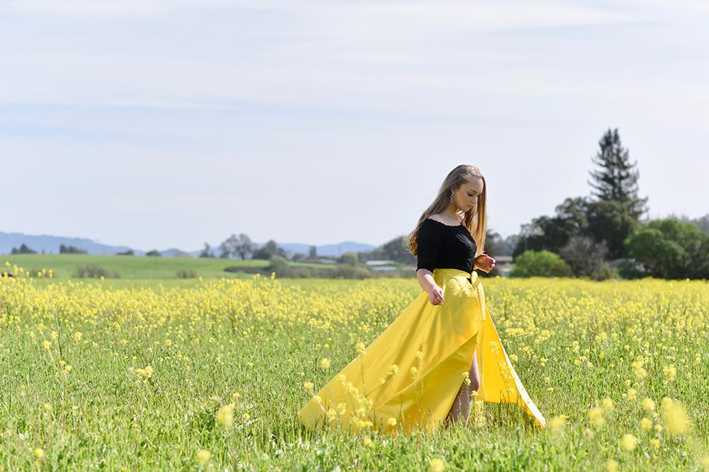 Senior girl in mustard fields