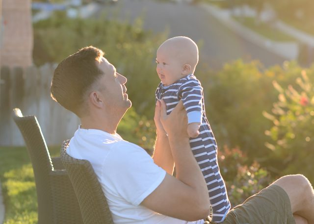 Baby and Father in sunset light