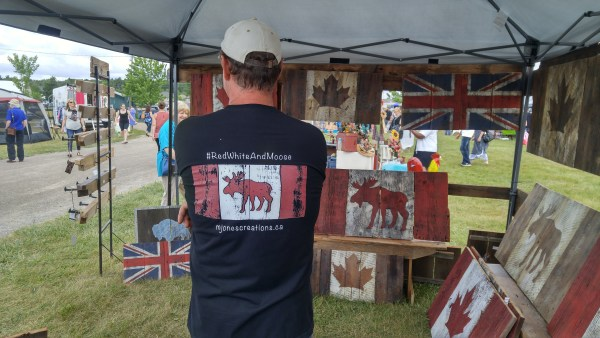 Red White and Moose Shirts in the M. Jones Creations booth