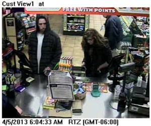 Male & Female Suspect at Cash Register