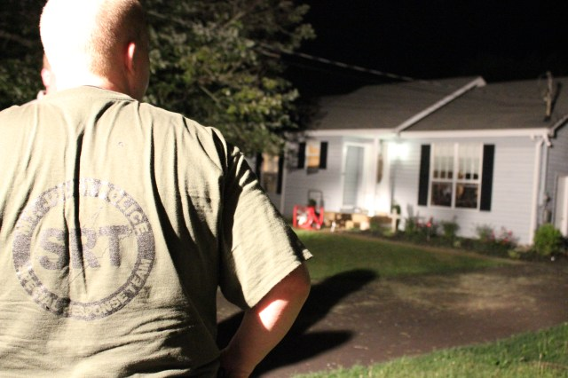 A SRT Member looks at the home where Crafton was barricaded.