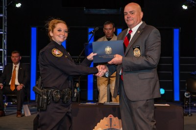 Photo of Officer Alecia Martin & TLETA Director Brian Grisham handing her certificate