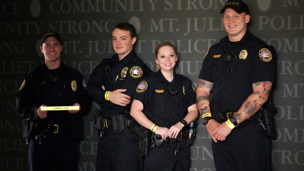 4 Officers Standing, Modeling Reflective Wristbands
