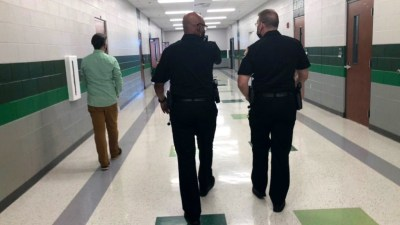 Chief Hambrick & Capt. Chandler walk the hallways of Green Hill High School with Principal Kevin Dawson.