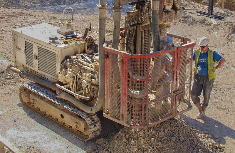 CFA piling rig on chalk ground installing a kingpost earthwork support scheme