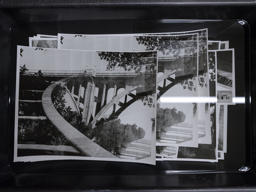 black and white darkroom prints soaking after fixer