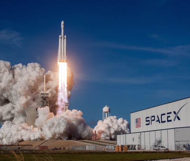 Spacexs First Falcon Heavy Rocket Climbs Into The Sky From Launch Pad 39a At Nasas Kennedy Space Center In Florida Credit Spacex