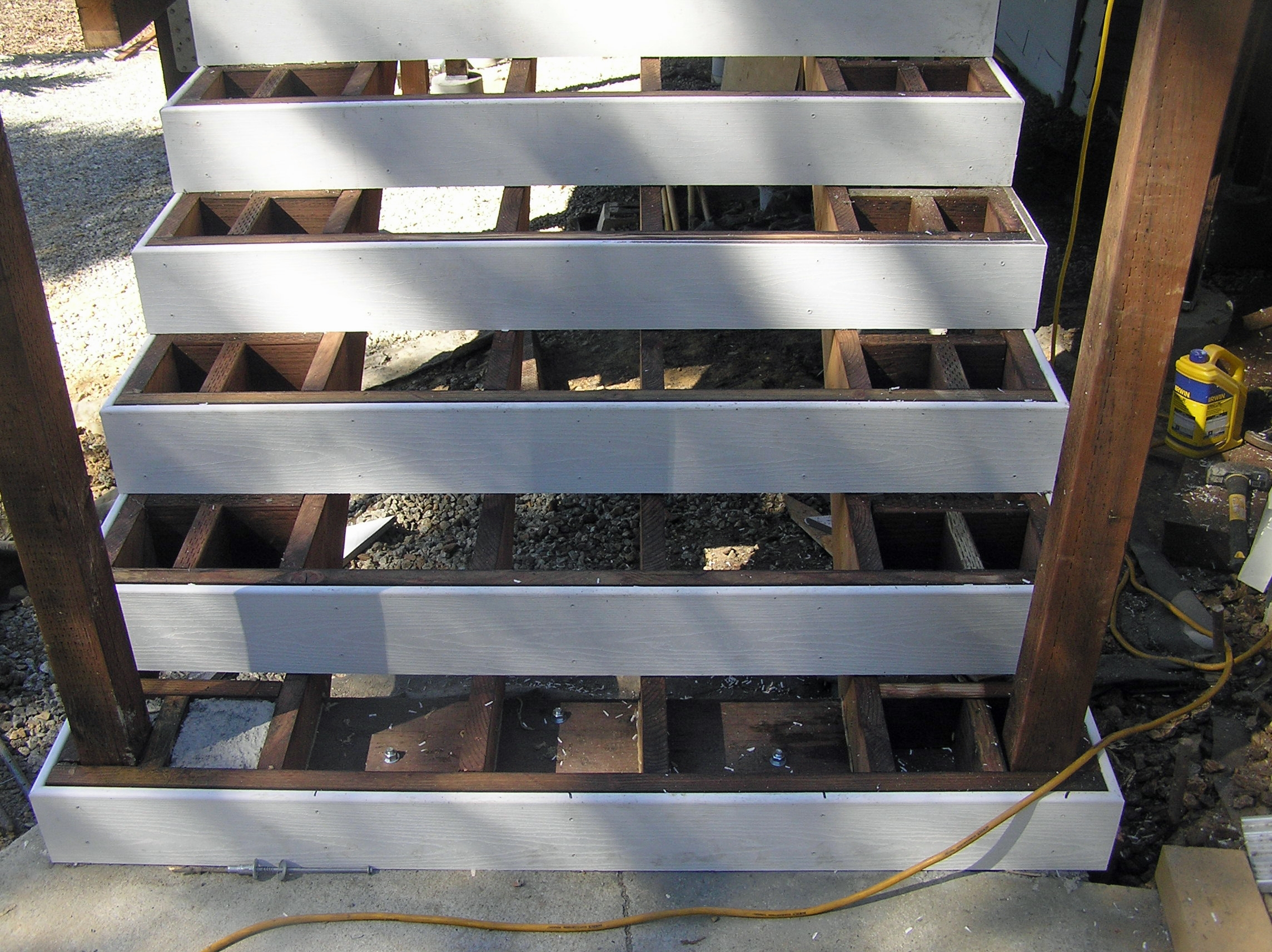 Attaching Bottom Deck Posts Thisiscarpentry | Attaching Wood To Concrete Steps | Composite Decking | Handrail | Staircase | Screws | Deck Stairs