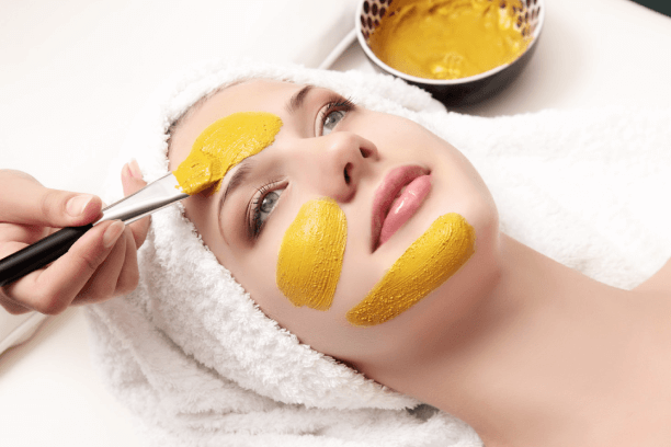 A woman with haldi face pack