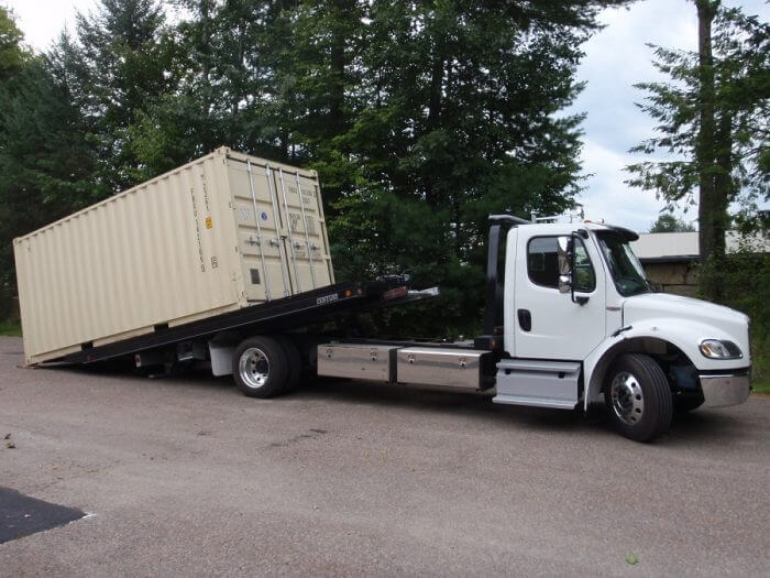 Storage container being delivered on-site