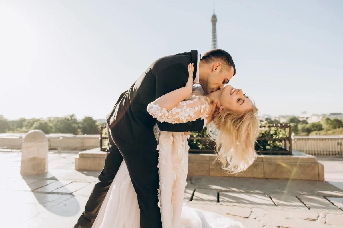 groom kissing bride neck