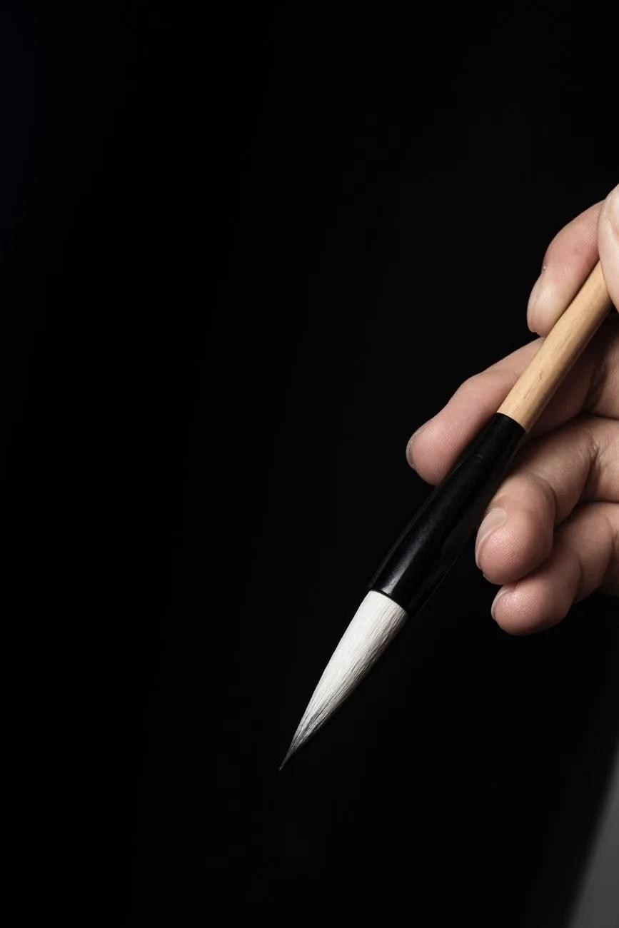 crop calligrapher with modern calligraphy brush pen