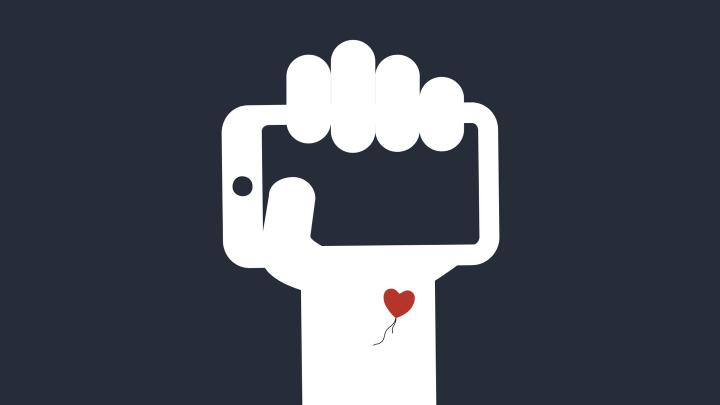Eine Hand hält ein Mobiltelefon - das Symbol für Cyborg-Rechte