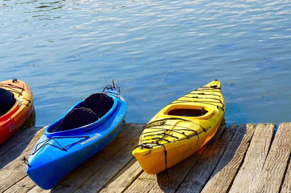 a pair of kayaks on a dock