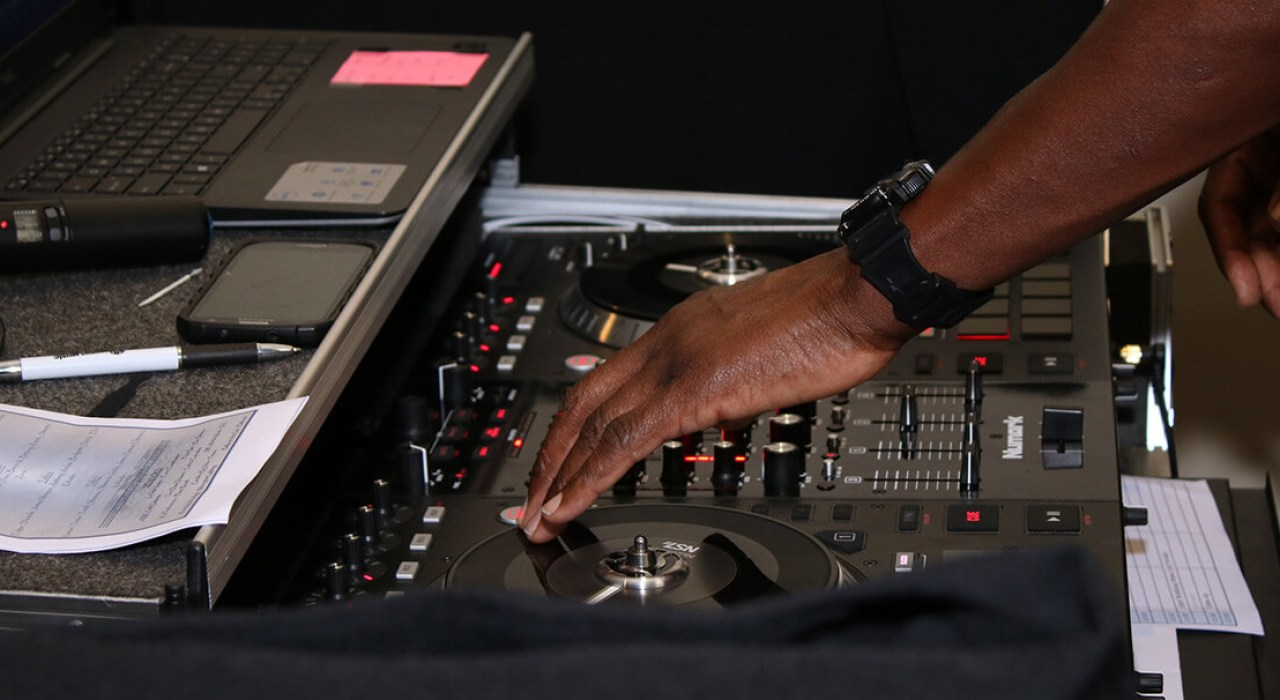close-up of DJ's hands mixing music