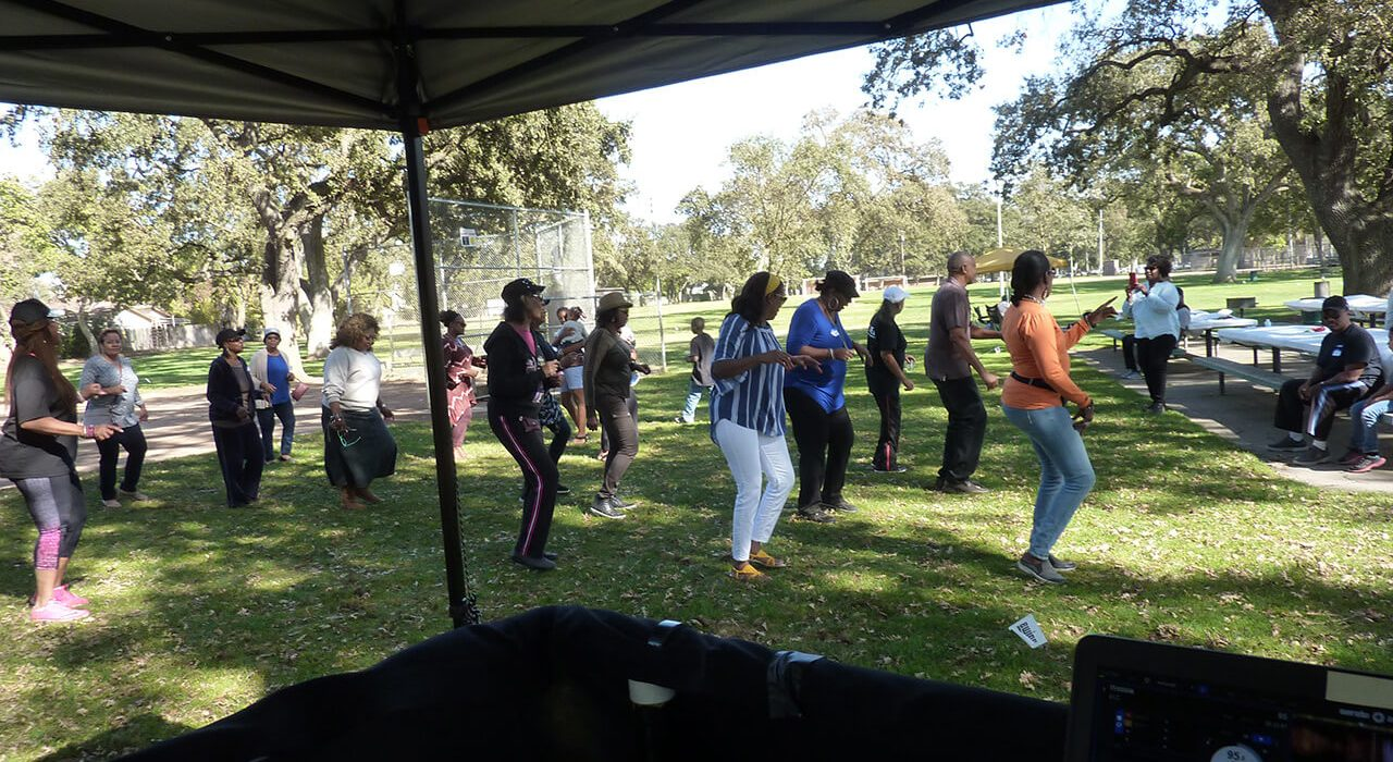 group of people dancing to dj music