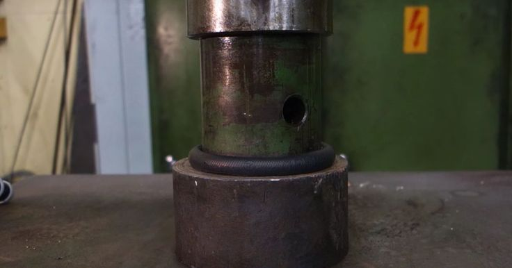 Hockey Pucks Are Supposedly Indestructible, So What Happens When One Meets A Hydraulic Press?