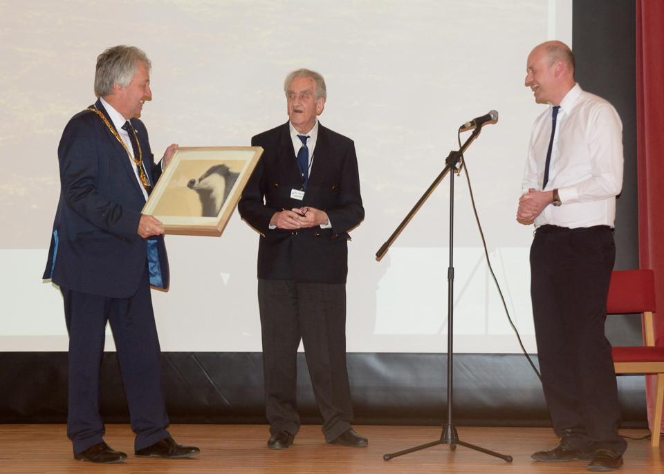David Hopkins (Milton Keynes Mayor) presents a painting of a badger to Roy Maycock (President)