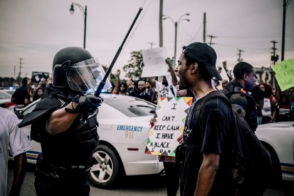 Protester yells at Memphis police officer holding a baton