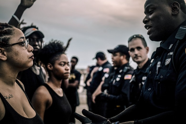 Black woman cries as line of protesters face off with Memphis police