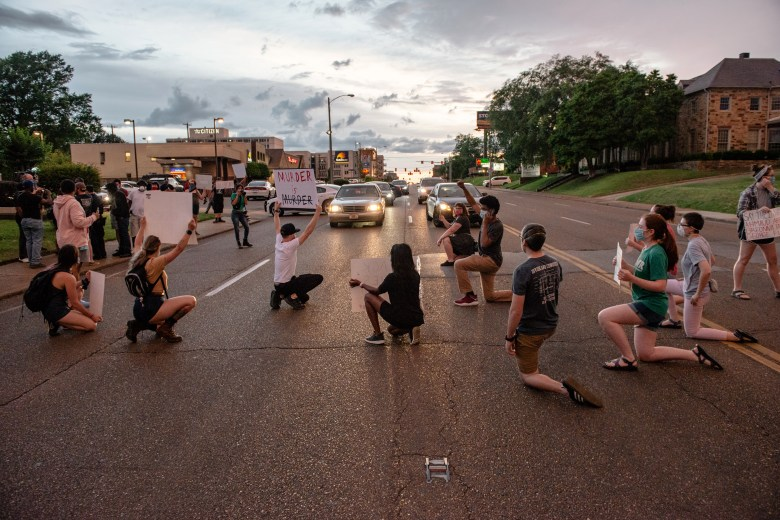 Protesters stop traffic along Union Avenue in Memphis, Tennessee, by kneeling in the roadway in May 2020.