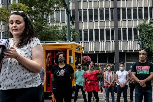 Chelsea Glass of DeCarcerate Memphis speaks to press members outside of the Clifford Davis-Odell Horton Federal Building.