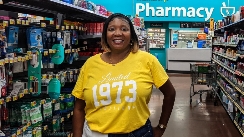 Nicole Wells stands for a portrait outside a Walmart pharmacy.