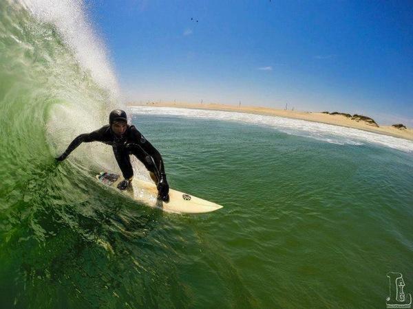 Iain surfing
