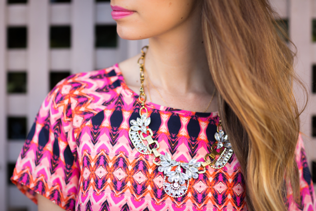 statement necklace with printed shift dress, M Loves M