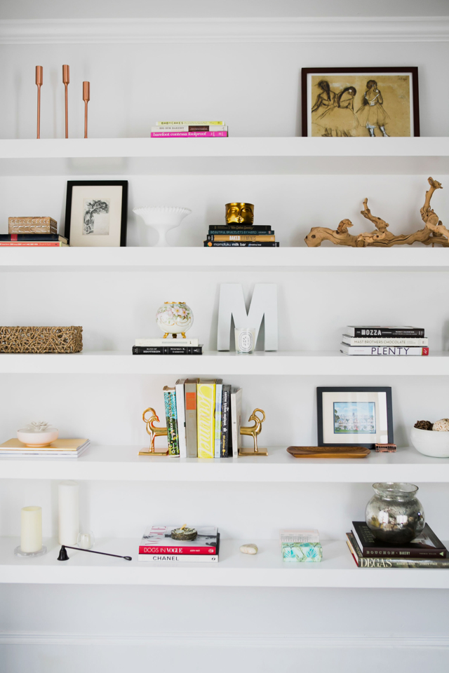 M Loves M Home Tour reading nook with floor to ceiling shelves @marmar
