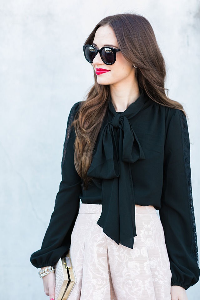 black bow blouse with lace detail on the sides M Loves M