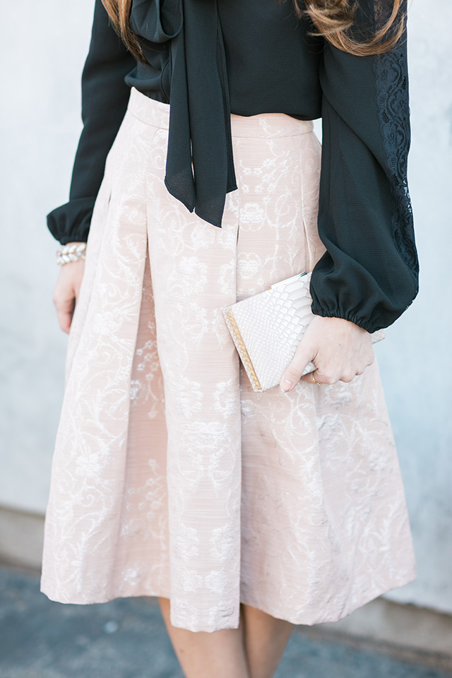 box pleated skirt with nude clutch on M Loves M