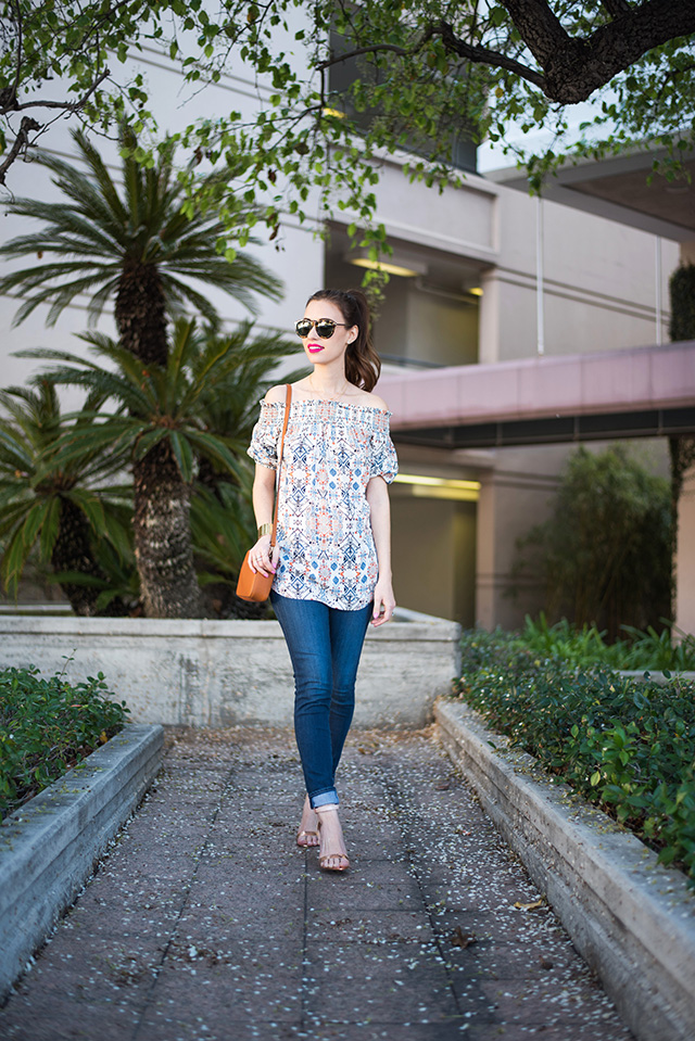 off the shoulder top with jeans and sandal heels M Loves M