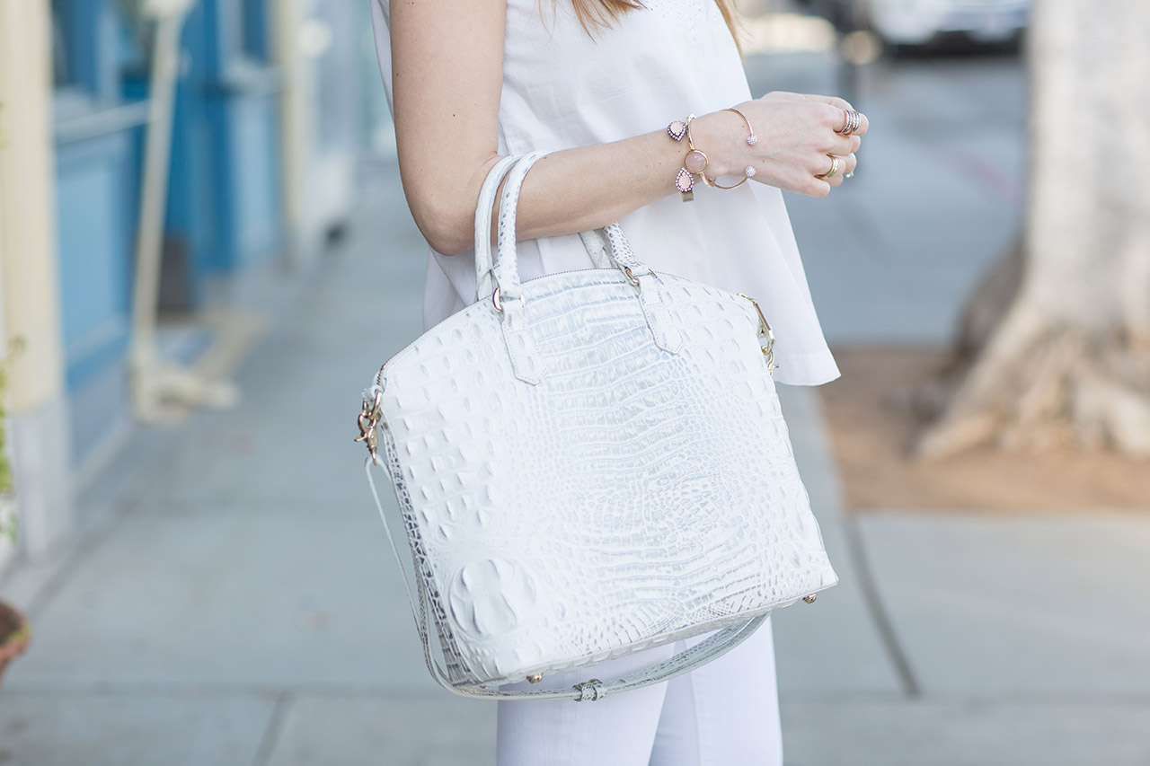 white exotic bag with white outfit