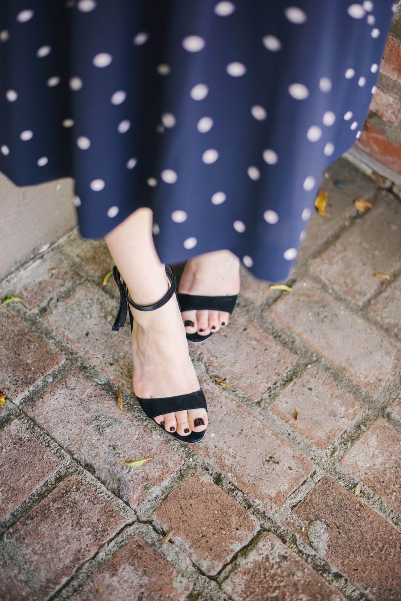 navy and white polka dot skirt with black sandal heels