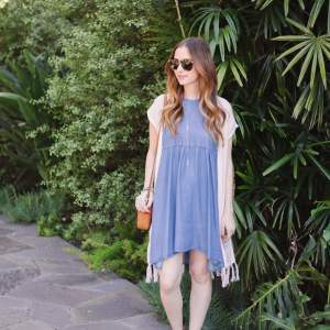 chambray halter dress with fringe vest and booties