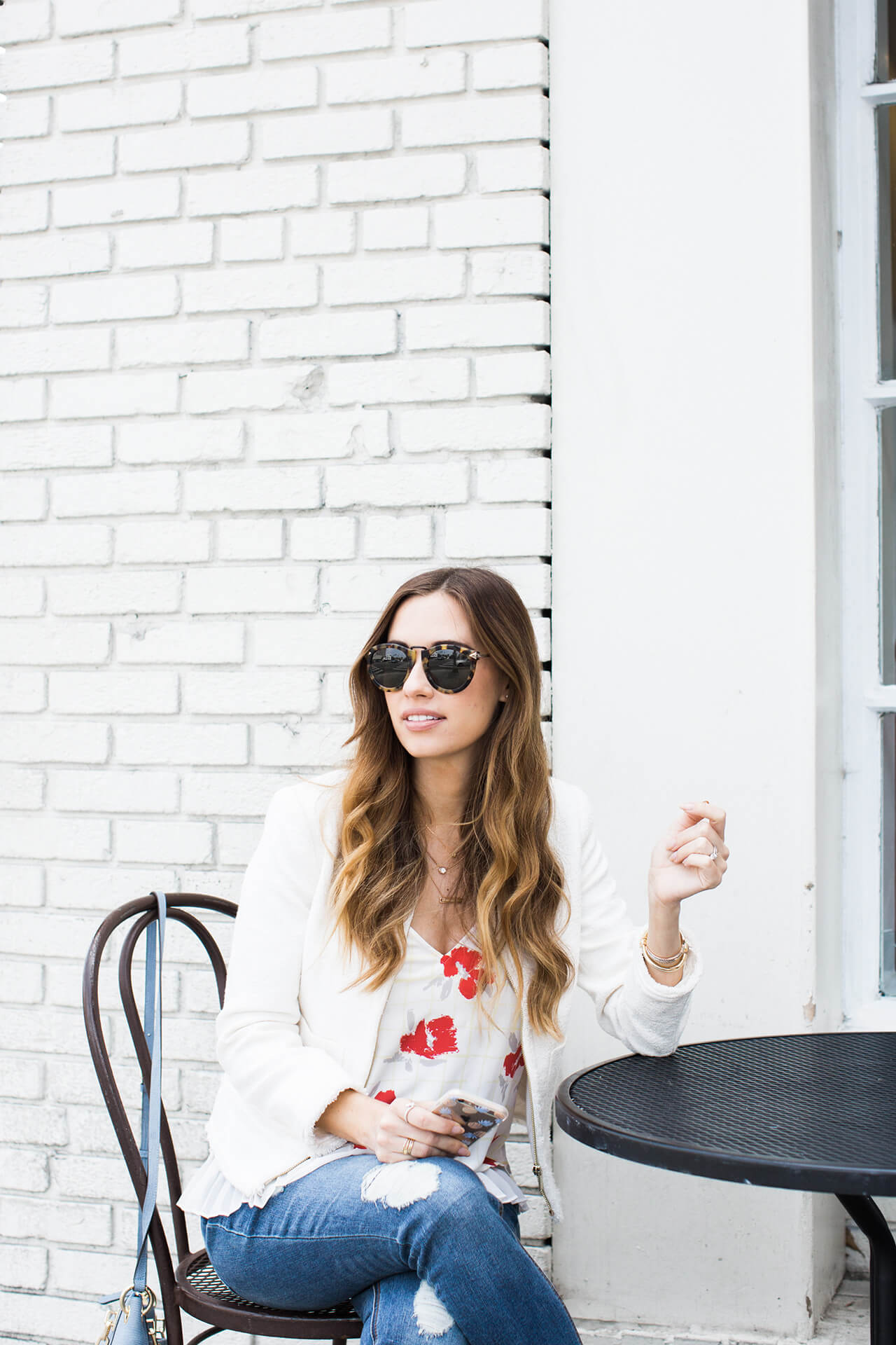 white jacket with floral top and distressed jeans