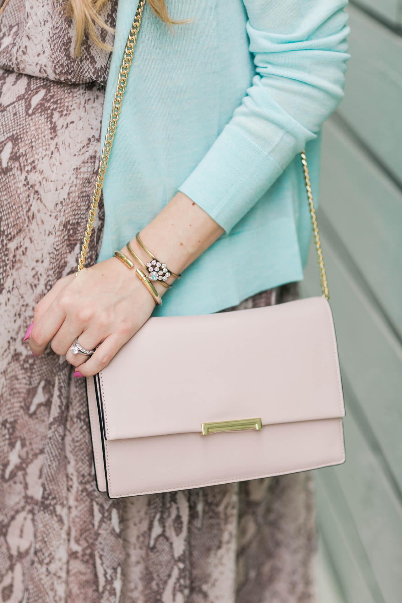 mint sweater with pink ivanka trump bag