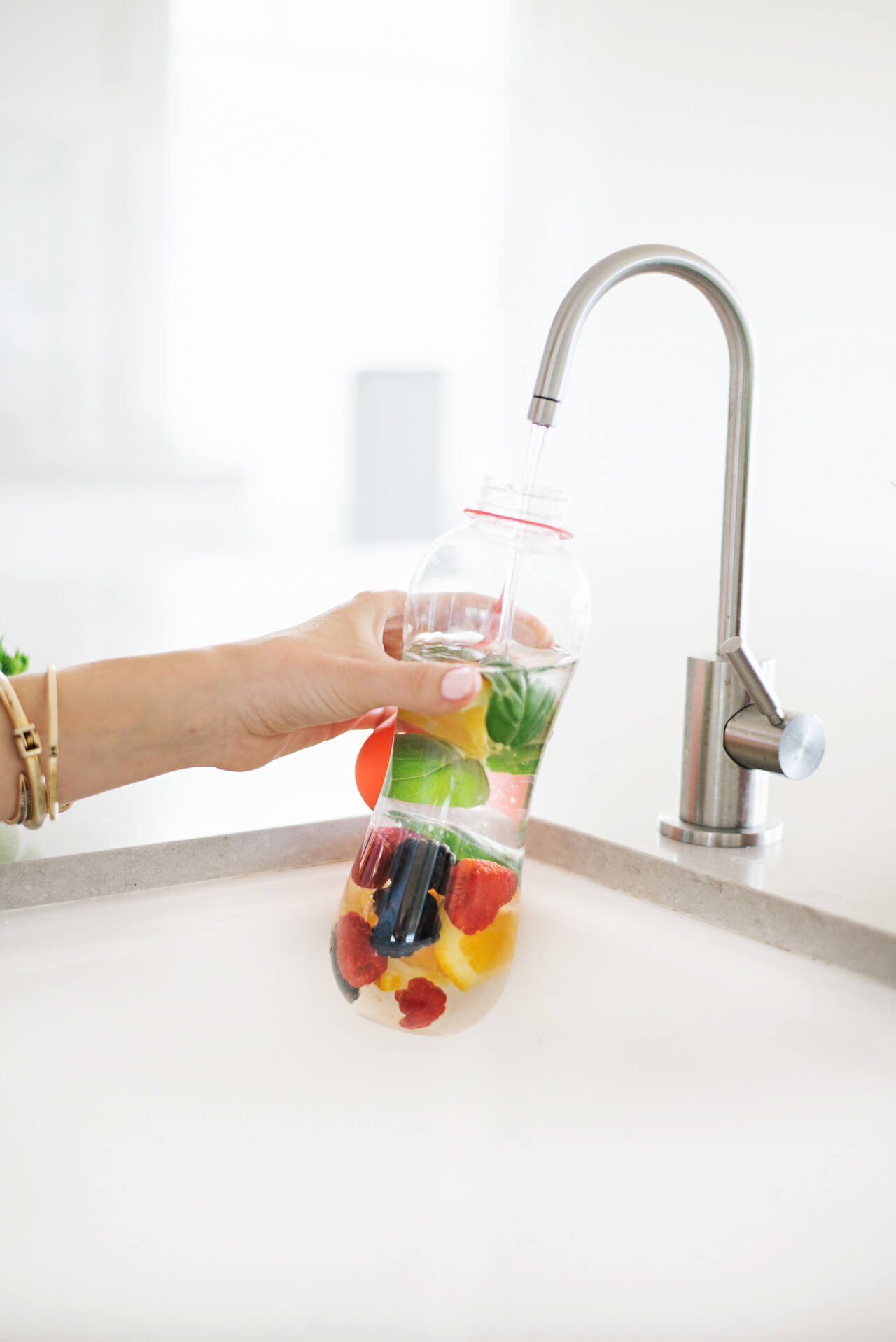adding filtered water to fruit