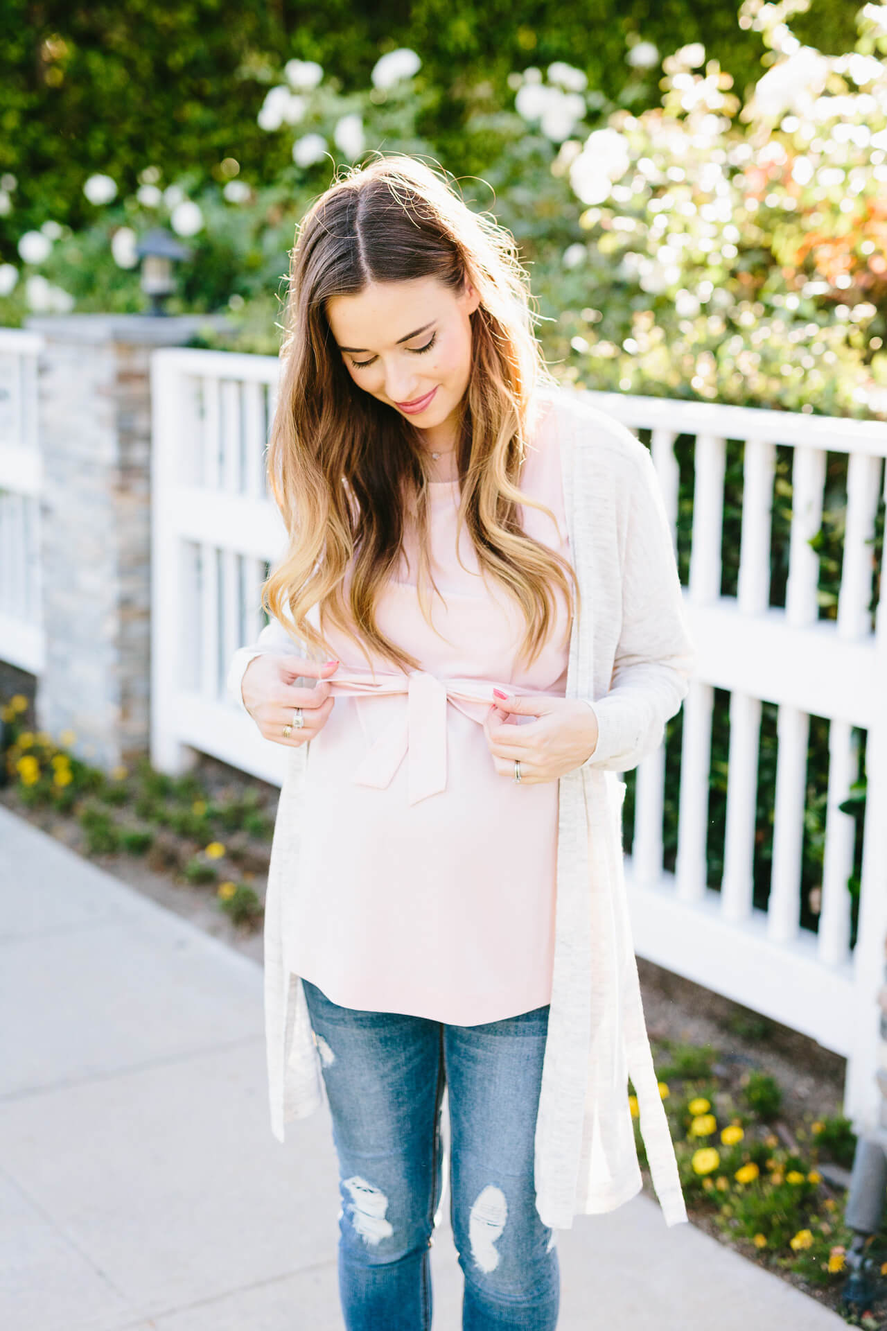 pretty blush pink belted top that works if you're pregnant or not