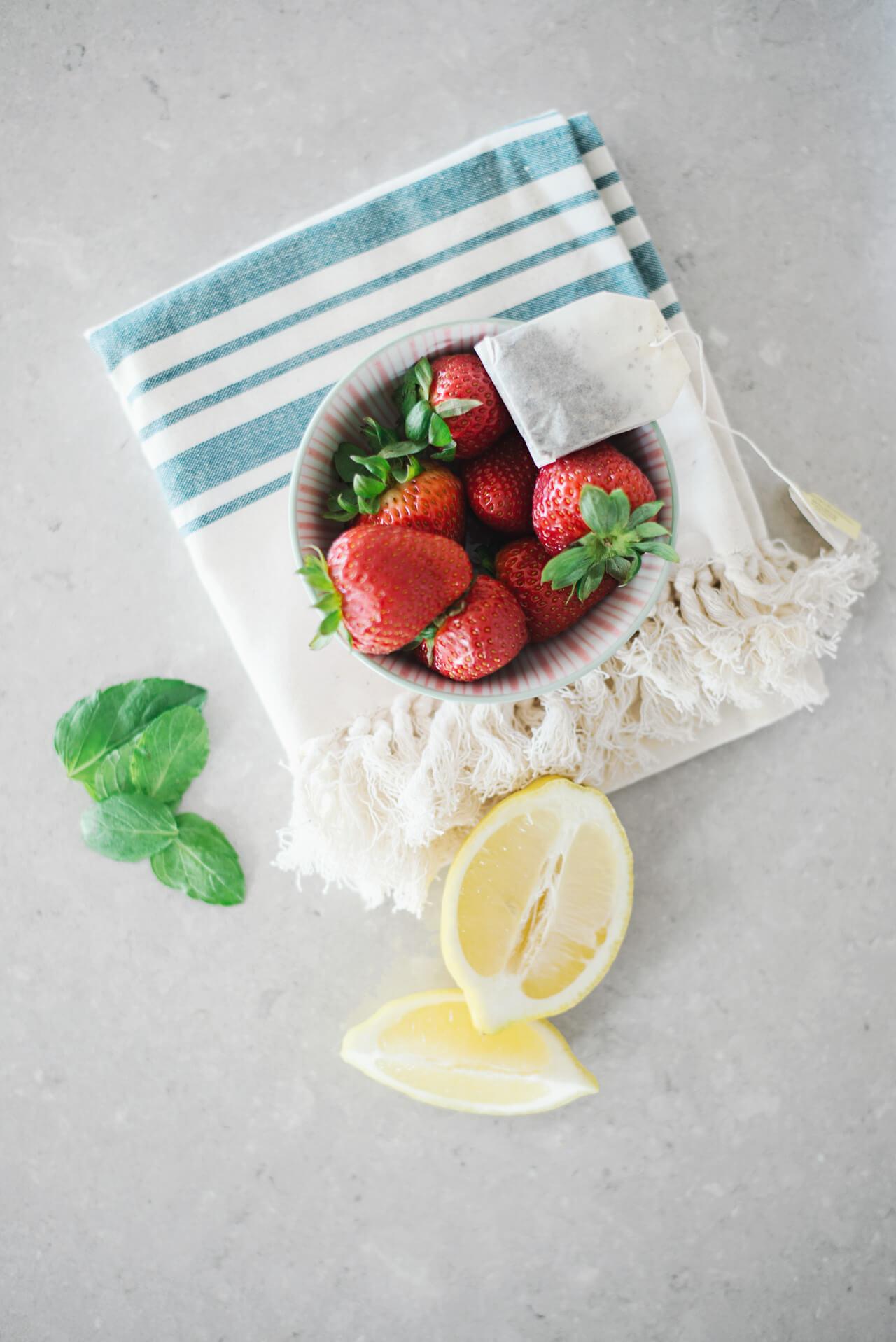 strawberries, lemon, mint and green tea infused water