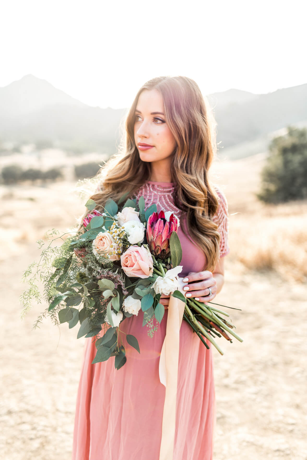 Mara Ferreira of M Loves M maternity shoot with gorgeous pink and green floral bouquet