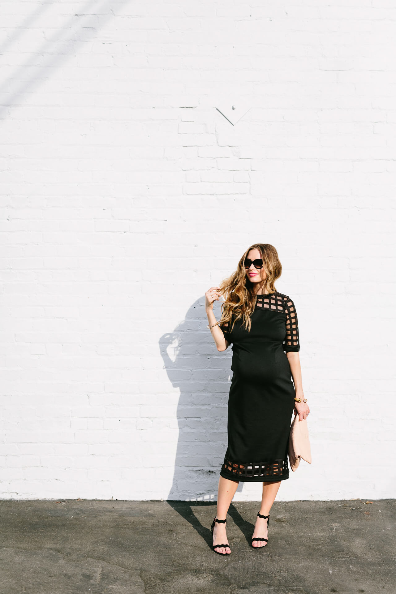 feminine black midi dress