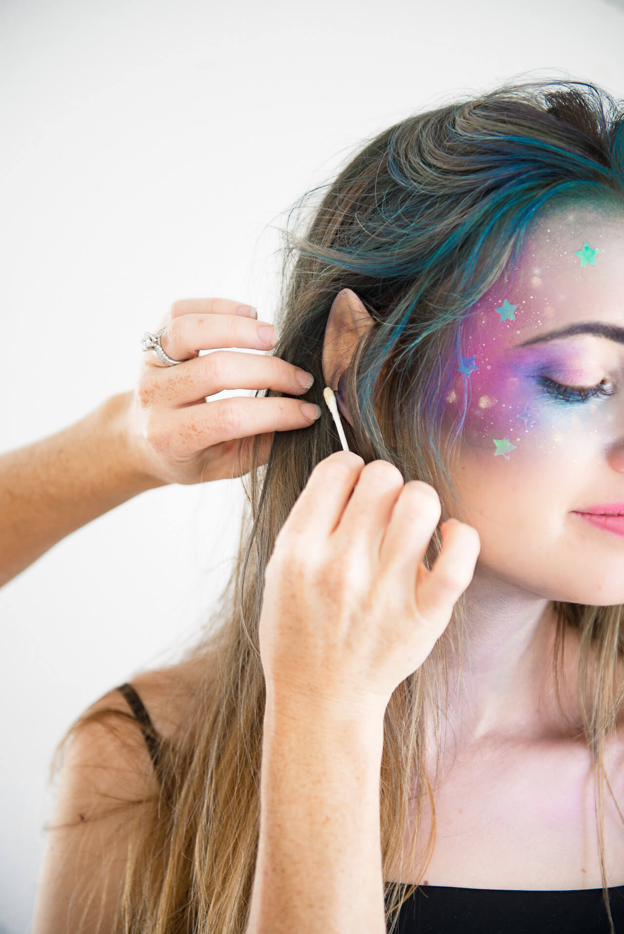 add fake ear to complete galaxy girl halloween costume