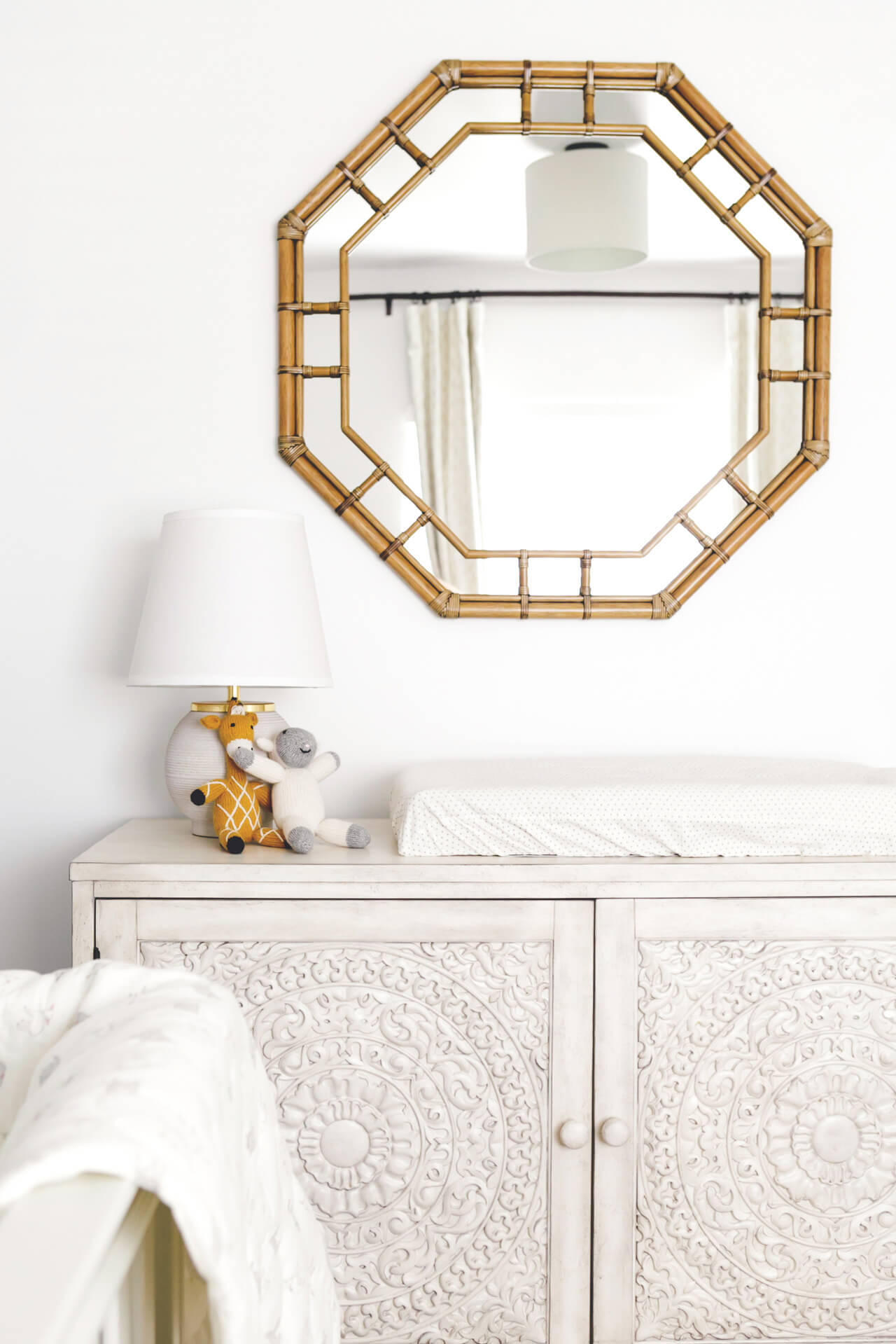 gender neutral nursery design with high fashion home chest and lulu & georgia mirror