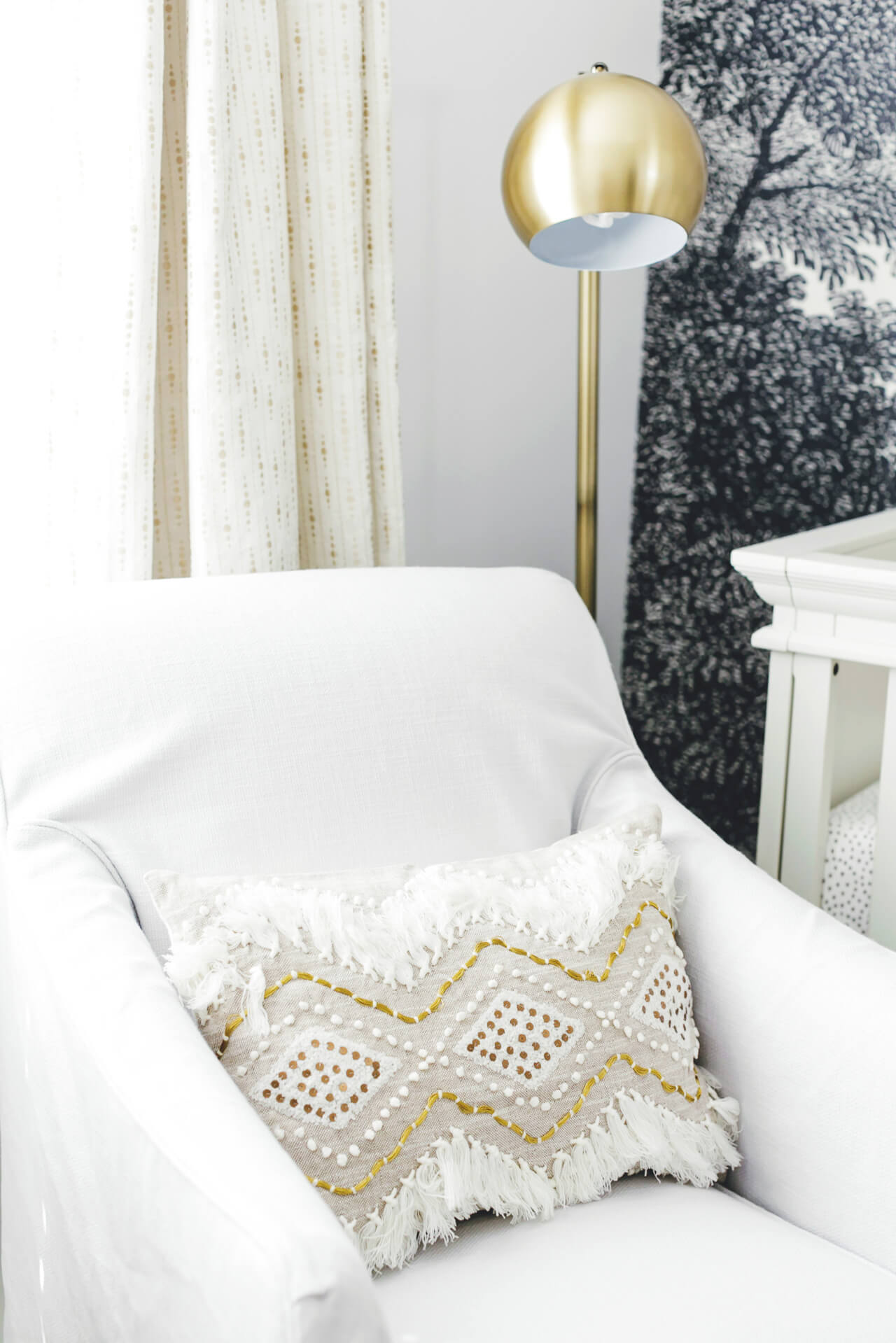 white chair with anthropologie moroccan pillow