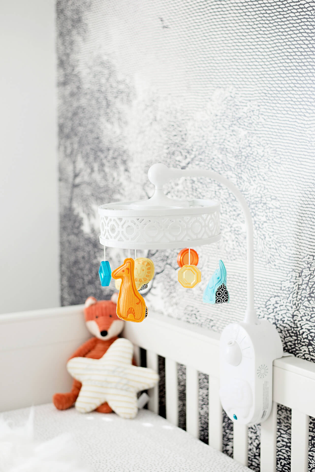 a cute and colorful nursery mobile