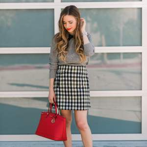 tweed a-line skirt with black flats and red bag